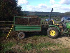 John Deere on horse manure duties
